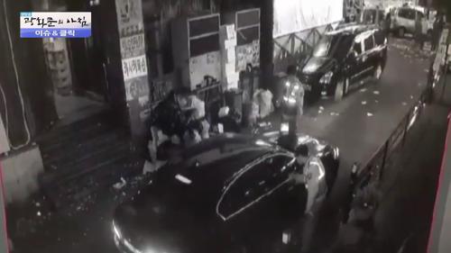 도주 차량 보닛에 매달린 경찰관?!